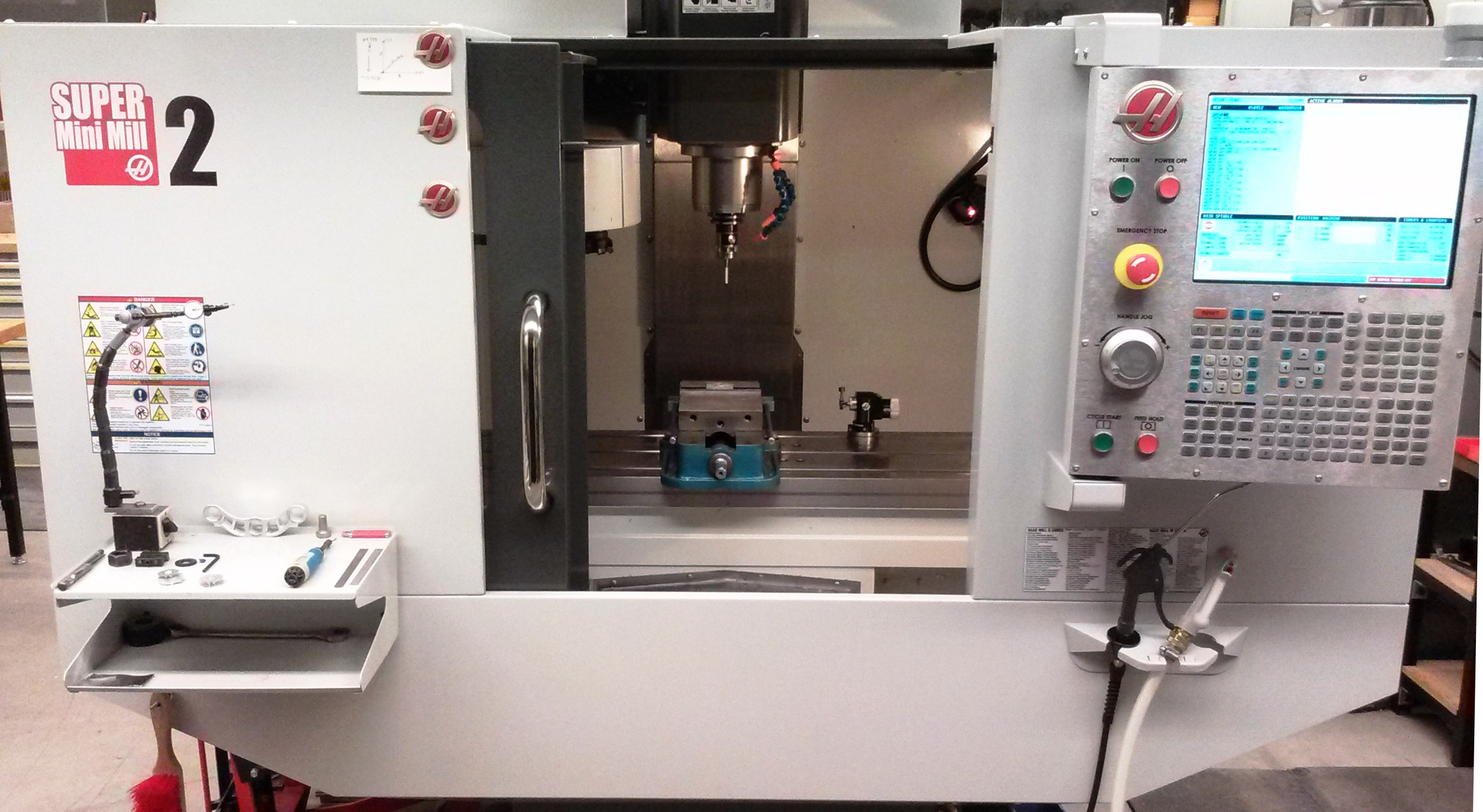 The Haas Super Mini Mill 2 CNC milling machine is capable of machining most plastics and metals with tolerances well within 0.001